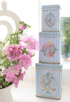 tins in pastel colours