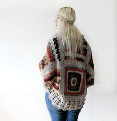 Wow this is beautiful. She has others that are just as beautiful. Afghan Crochet CardiganIvory by LoveandKnit on Etsy, $125.00