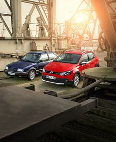 A beautiful sunset in an industrial setting for a photo shoot featuring two Volkswagen Polo generations: the red Polo Cross is a modern successor of the blue Polo II GT G40 that was first introduced in 1987.