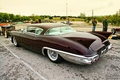 1957 Cadillac with a paint that looks deep enough to swim in and eve has the shark fins to boot. :)