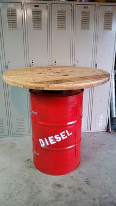 "55 gallon drum table. repurposed barrel. bar height.  42"" high. 42"" around."