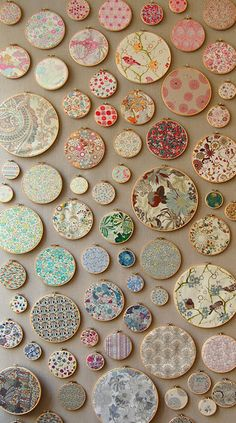 my dream wall installation.... the famous Liberty fabrics displayed in embroidery hoops. Too gorgeous!