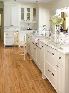 CABINETS: BEHR IVORY KEYS T 16-17. Ivory in the kitchen creates a modern farmhouse feel paired with marble counter tops, subway tile and a farmhouse sink. Natural light works wonders in an all-white room, and the dimension introduced by the molding arched doorways goes a long way. *