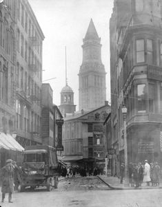 Elm Street, 1920. Faneuil Hall in foreground. Streets have changed entirely now. Before Faneuil Hall was revered as historical, Pillsbury billboarded on it.