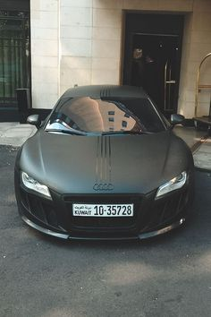 Audi R8 in matte black with shiny lines from the logo to the back.