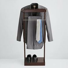 "Deluxe Standing Valet $149.95 Keep your clothes organized. This valet measures 45"" high x 17.5"" wide x 11"" deep, and has an espresso finish. Hang your coat/shirt on the wood hanger, and your pants/ties on an adjoining brushed nickel pant hanger. Store your change or keys in the accessory tray, and shoes on the bottom step. This valet is perfect to get your clothes ready for the next busy morning. - See more at: http://gifts.redenvelope.com/gifts/deluxe-standing-valet-30055618?"
