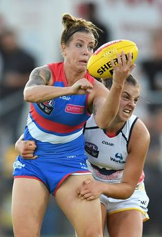 Ebony Marinoff Photos - Hannah Scott of the Bulldogs is tackled by Ebony Marinoff of the Crows during the round two AFL Women's match between the Western Bulldogs and the Adelaide Crows at Whitten Oval on February 10, 2017 in Melbourne, Australia. - AFL Women's Rd 2 - Western Bulldogs v Adelaide Crows