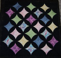 Love the black background! Cathedral Window Quilt Pattern by Springwaterdesigns on Etsy