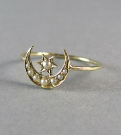 Victorian seed pearl star and moon ring, very delicate. Converted into ring from pin, using stem for ring--clever, and makes the ring feel fresh in concept and modern in design (stacking ring).
