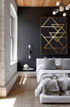 Black wall with black & gold artwork. Sisal rug and the most simple gorgeous bedside table