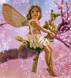 Our miniature cherry blossom fairy figurine brings the joy of spring to your miniature fairy gardens.