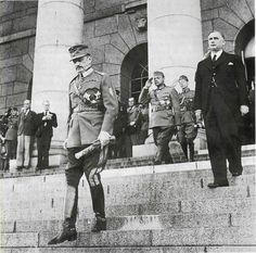 Marshal Karl Gustav Mannerheim leaves the building of the Finnish parliament after he was elected president of the country on August On the sleeve of his tunic is sewn a chevron of the Civil Guard. History Of Finland, Night Shadow, Fight For Us, High Resolution Photos, Military History, Old Pictures, Historical Photos, World War Ii, Wwii