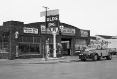 In 1946, GMC resumed building civilian trucks after producing vehicles for WWII. Pictured here is a 1946 GMC Truck near mechanic shop.