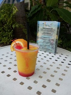 Our Tiki Bar serves up several Signature Drinks like this Mallory Mango Sunset! Delicious! www.theinnatkeywest.com