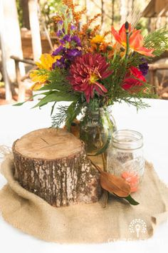 Burlap, wood and a gorgeous bouquet of fall flowers inside a mason jar with smaller mason jay candles Bottle Centerpieces, Wedding Centerpieces, Wedding Decorations, Table Decorations, Fall Flowers, Wedding Flowers, Fall Wedding, Dream Wedding, Wedding Ideas