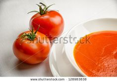 Tomato soup in a white plate by MilaCroft, via ShutterStock