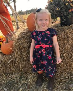 Loving fall even though it doesn't feel like it weatherwise!  But Cora was happy to wear this dress and a navy shabby flower hair clip since her favorite color is blue!  #misscora #luckyladd #navyandorange #pumpkins #bellejulietsbowtique #shopbellejuliets