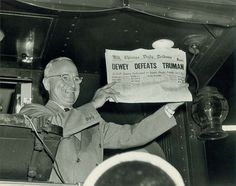 Harry S. Truman holding newspaper that falsely states Dewey Defeats Truman in the presidental race.