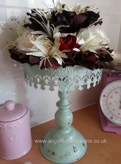 Black Forest Gateau Flower on distressed style cake stand. Unique design by www.angelfloraldesigns.co.uk