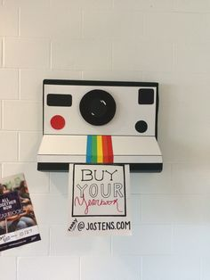 Marketing idea for yearbook class. We then made small polaroid camera around the… Marketing idea for yearbook class. We then made small polaroid camera around the school kids could pull an ad from. Yearbook Class, Middle School Yearbook, Teaching Yearbook, Yearbook Shirts, Yearbook Pages, Yearbook Spreads, Yearbook Covers, Yearbook Layouts, Yearbook Design