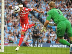 Bobby Zamora heads QPR level at the Etihad