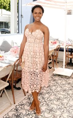 Tika Sumpter is wearing a cream laser cut floral Self Portrait dress. This is the perfect dress for summer! Tika is lovely in it!