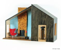 These Wall Mounted Mid-Century Modern Dollhouses are made to double as actual shelving for small objects.