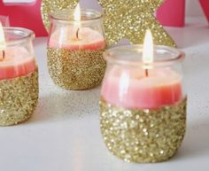 DIY Gold Glitter Candle Holders- this would be cheap to do :) I just love the glitter on it. It just gives it a pop :)