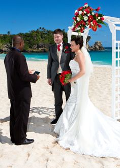 Intimate Weddings in Barbados, Blue skies, white beaches and a lovely rose and carnation arch.