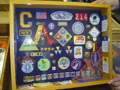 Cub Scout Shadow Box- this is more like it.  ...this kind of thing for each boy... If boys make it, will count toward Craftsman pin.