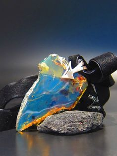 Blue amber pendant, Africa Roots - tribal transparent natural Dominican blue amber slab