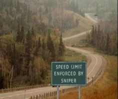 Speed limit enforced by sniper. I bet they don't get any speeding there.