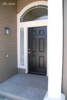 Sherwin Williams -- House Color:  SW 7032 Warm Stone, Trim:  SW 6140 Moderate White, Door:  Black