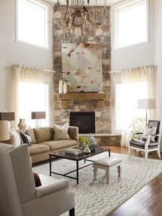 Alice Lane Home - living rooms - corner fireplace, living room fireplace, stone fireplace, corner hearth, fireplace art, 2 story living room...