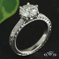Custom 14kt warm white gold mounting holding a 6-prong 7mm round cut center stone in a pierced scalloped head. - See more at: http://www.greenlakejewelry.com/gallery/cust_gallery.aspx?ImageID=97906#sthash.SUisDuHi.dpuf