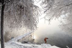 Retired teacher Gao Yinyu, 77, prepares to go for a swim in the nude in Jilin, China in -25 degrees Celsius weather.