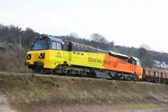Colas Rail Freight Class 70 No. 70801 stands with a ballast train on the down line between Teignmouth and Bishopsteignton on 29 March 2014 which involved with restoring services over the Sea