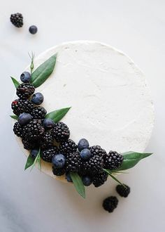 This black and white cake is a three layer dessert made of dark cocoa cake, a cooked flour vanilla bean frosting and blackberry ganache. Vanilla Bean Frosting, Vanilla Cake, Fall Wedding Cakes, Party Wedding, Black White Cakes, Cocoa Cake, Blackberry Cake, Cupcake Cakes, Cupcakes