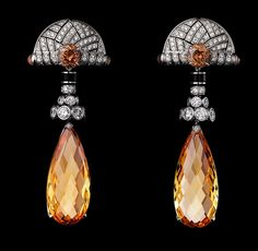 Cartier Platinum Earrings - two briolette-cut golden imperial topazes totaling 28.11 carats, cabochon-cut colored sapphires, round colored sapphires, obsidian, brilliants