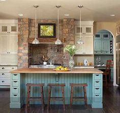 Love the blue color, the stools, and the brick in the wall