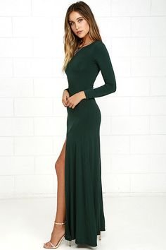 Feel like you're walking on air in the Swept Away Forest Green Long Sleeve Maxi Dress! Super soft and stretchy jersey knit shapes a rounded neckline, long sleeves, and a flowy maxi skirt with side slit.
