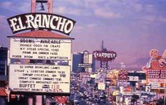 """View of the Las Vegas Strip during the day, looking southwest from the El Rancho marquee signs in 1986. Other signs visible are Circus Circus, Slots-A-Fun, the Stardust, the Frontier and part of Westward Ho.  Image is part of UNLV Libraries """"Photo"""" digital collection."""