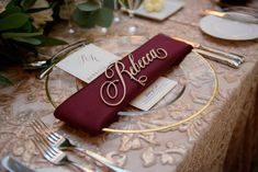 Elegant Fall Wedding with Burgundy & Gold Color Palette in Florida wedding reception pattern texture nuage designs linen gold charger burgundy napkin gold name cutout. Wedding Name, Wedding Places, Wedding Place Cards, Wedding Rings, Wedding Table Decorations, Wedding Table Settings, Wedding Centerpieces, Quinceanera Centerpieces, Wedding Tables
