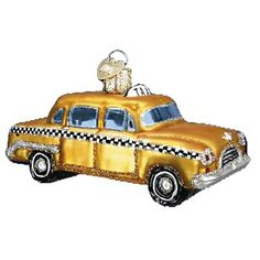 "Taxi Christmas Ornament 46027 Merck Family's Old World Christmas Cab car measures approximately 4"" Yellow car with black and white checkering, glitter details. Taxicabs have provided"