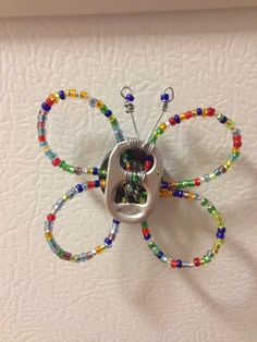 Butterfly soda tab. No instructions, but looks like it could be reverse engineered.