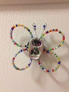 mariposa con anillas de latas
