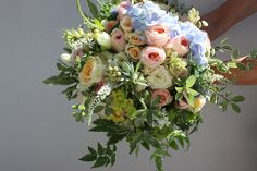 Gorgeous bouquet of mixed flowers and greenery for Pip's wedding