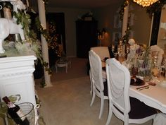 Shabby chic purple dining room decorated for Christmas with jewels on the back of the chairs