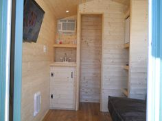 Not ideal from my perspective (kitchen doesn't have a good space, for starters) but some great details, especially the shower! kens-tiny-house-3