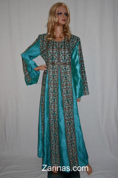 Um Kalthoom Dress (Thawb) - Blue Gorgeous dress made from a fabulous charmeuse fabric and decorated with an elegant embroidered pattern, covered with beautiful jewels. The gown has an adjustable belt at the waist. The fit is long and the style is traditional, perfect for parties, weddings, or special occasions. Available in two colors, blue and pink. Made in Jordon, 100% polyester.   http://www.zarinas.com/dresses_jordan_palestine.shtml